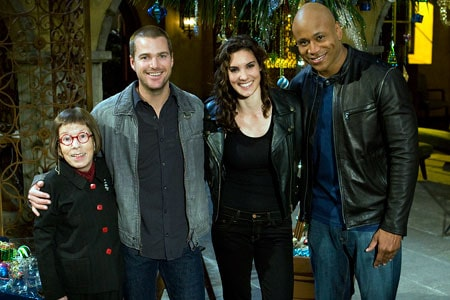 The cast of NCIS: LA on set pose for a picture between takes.